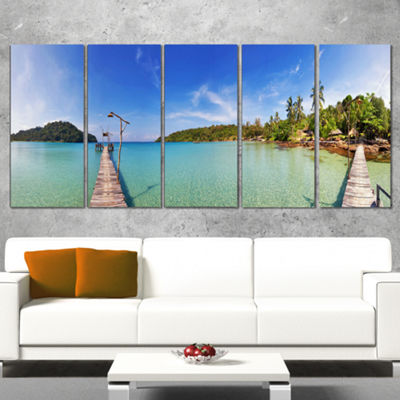 Designart Piers and Palm Trees on Island LandscapePhotography Canvas Print - 5 Panels