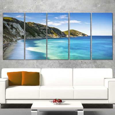 Designart Portoferraio Sansone White Beach Extra Large Seashore Canvas Art - 4 Panels