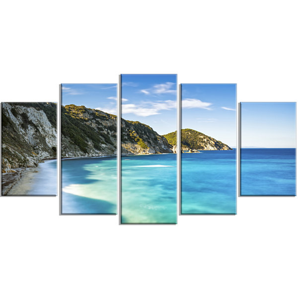 Designart Portoferraio Sansone White Beach Extra Large Seashore Wrapped Canvas Art - 5 Panels