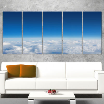 Designart Puffy Clouds Above View Extra Large WallArt Landscape - 4 Panels