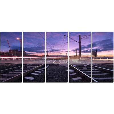 Designart Rail Crossing With Blurred Car Lights Cityscape Photo Canvas Print - 4 Panels