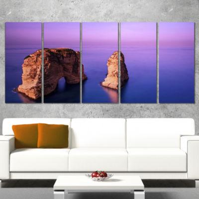 Designart Rawsha Rock on Sunset Seascape Wrapped Canvas ArtPrint - 5 Panels