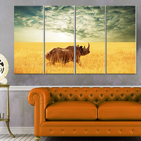 Designart Rhino in Grassland Under Cloudy Sky African CanvasArt Print - 4 Panels