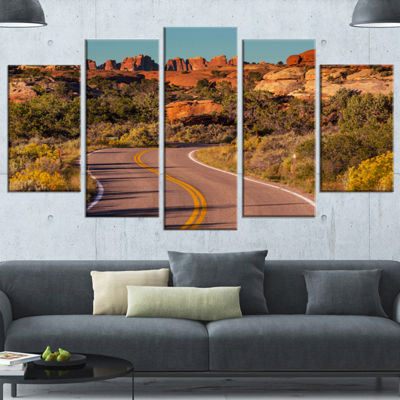 Designart Road in Rocky American Prairie LandscapeWrapped Canvas Art Print - 5 Panels