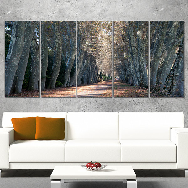 Designart Road in Thick Autumn Woods Modern ForestCanvas Art - 5 Panels