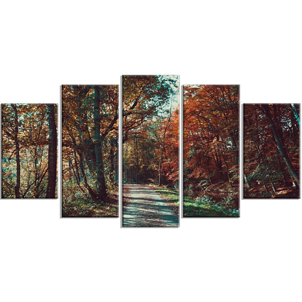 Designart Road Through Red Fall Forest Landscape Photo Canvas Art Print - 5 Panels