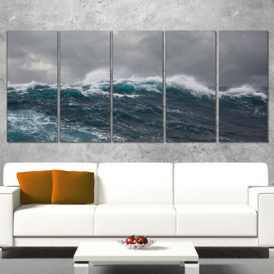Designart Roaring Waves Under Cloudy Sky SeascapeCanvas ArtPrint - 4 Panels