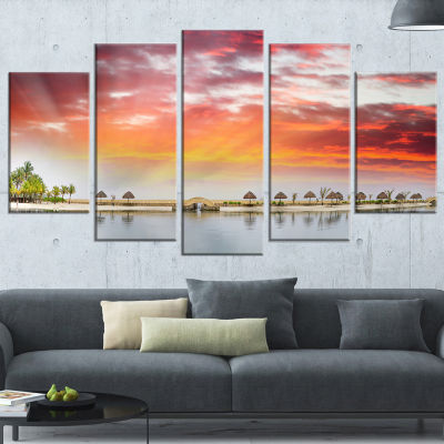 Designart Roatan Beach Sunset Panorama Seashore Photo Wrapped Canvas Art Print - 5 Panels