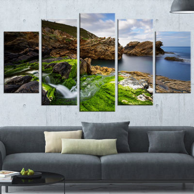 Designart Rocks and Waterfall in Spanish Coast Seashore Photo Canvas Print - 4 Panels