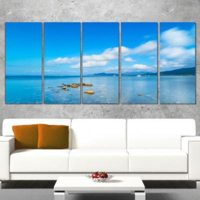 Designart Rocks in A Blue Panoramic Sea Bay ExtraLarge Seashore Wrapped Canvas Art - 5 Panels