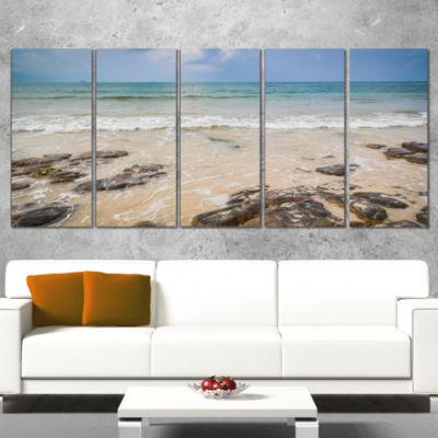 Designart Rocks on Typical Tropical Beach Beach Photo Wrapped Canvas Print - 5 Panels