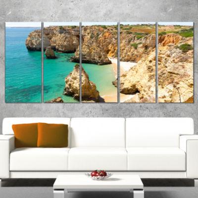 Designart Rocky and Rough Portugal Bay Extra LargeSeashoreWrapped Canvas Art - 5 Panels