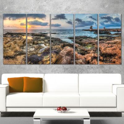 Designart Rocky Blue Seashore Sunset Extra Large Seashore Canvas Art - 4 Panels