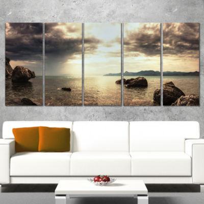 Designart Rocky Seashore Under Clouds Panorama Modern BeachCanvas Art Print - 4 Panels