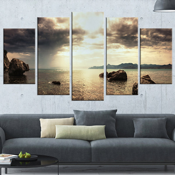 Designart Rocky Seashore Under Clouds Panorama Modern BeachWrapped Canvas Art Print - 5 Panels