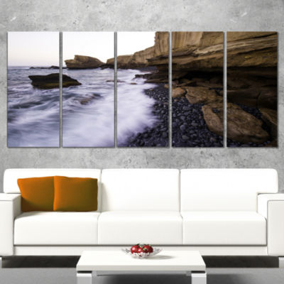Designart Rolling Stones At Beach Seashore Photo Canvas ArtPrint - 4 Panels