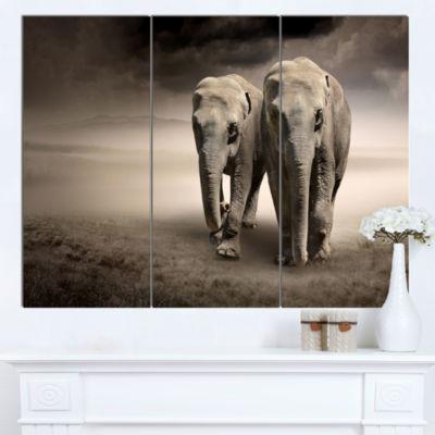 Designart Elephant Pair In Motion Animal Canvas Wall Art - 3 Panels