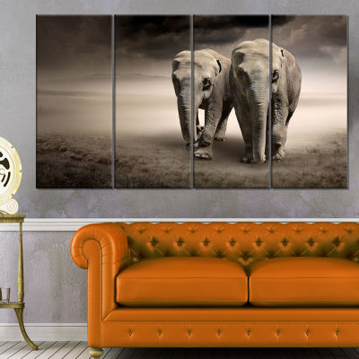 Design Art Elephant Pair In Motion Animal Canvas Wall Art - 4 Panels