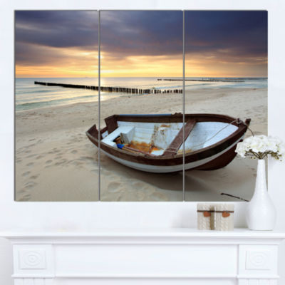 Designart Boat On Beautiful Sunrise Seashore BeachCanvas Wall Art - 3 Panels