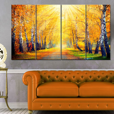 Designart Yellow Autumn Trees In Sunray LandscapeCanvas Art Print - 4 Panels