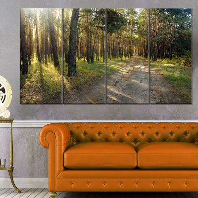 Designart Road Through Green Pine Forest LandscapePhotography Canvas Print - 4 Panels