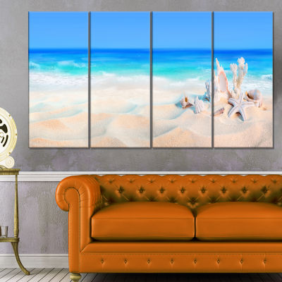 Designart Seashells On Seashore Beach PhotographyCanvas Art Print - 4 Panels