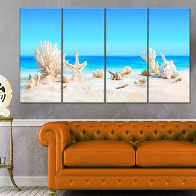 Designart Seashells On Tropical Beach Seashore Photo Canvas Print - 4 Panels