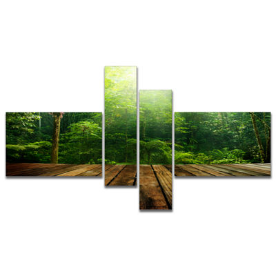 Designart Green Forest With Ray Of Light Multipanel Landscape Photo Canvas Art Print - 4 Panels