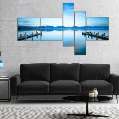 Designart Two Wooden Piers In Blue Sea MultipanelSeascape Canvas Art Print - 5 Panels