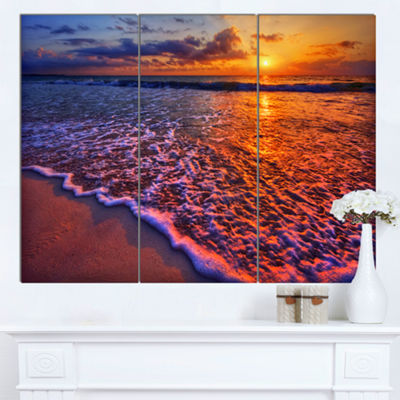 Designart Colorful Sunset And Wavy Waters SeashoreCanvas Art Print - 3 Panels