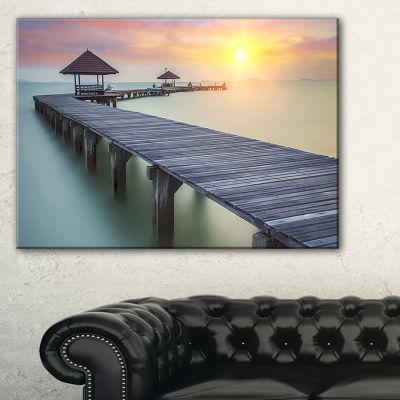 Designart Wooden Sea Bridge And Sunset Seashore Photo Canvas Print