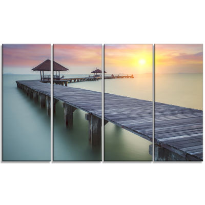 Designart Wooden Sea Bridge And Sunset Seashore Photo Canvas Print - 4 Panels