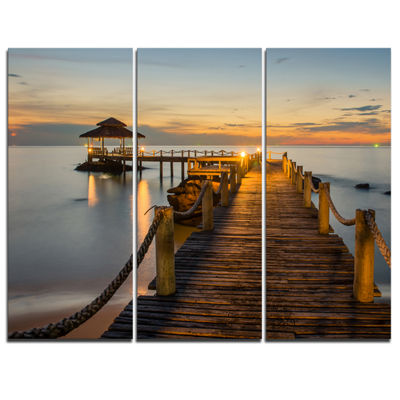 Designart Brown Wooden Pier In Evening Seashore Photo Canvas Print - 3 Panels