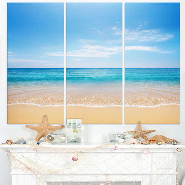 Designart Wide Blue Sky Over Beach Seashore PhotoCanvas Print - 3 Panels