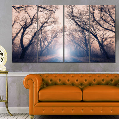 Designart Mysterious Sunlight In Forest LandscapePhoto Canvas Art Print - 4 Panels