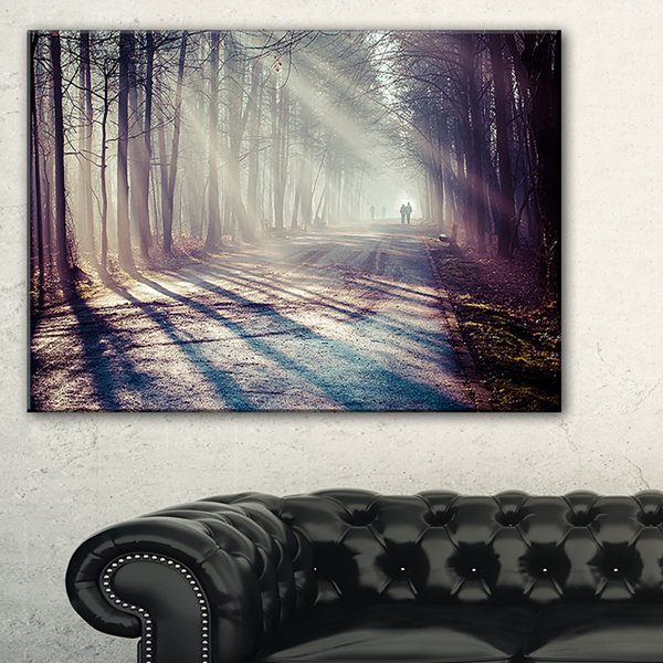 Designart Strong Sunbeams In Thick Forest Landscape Photography Canvas Print