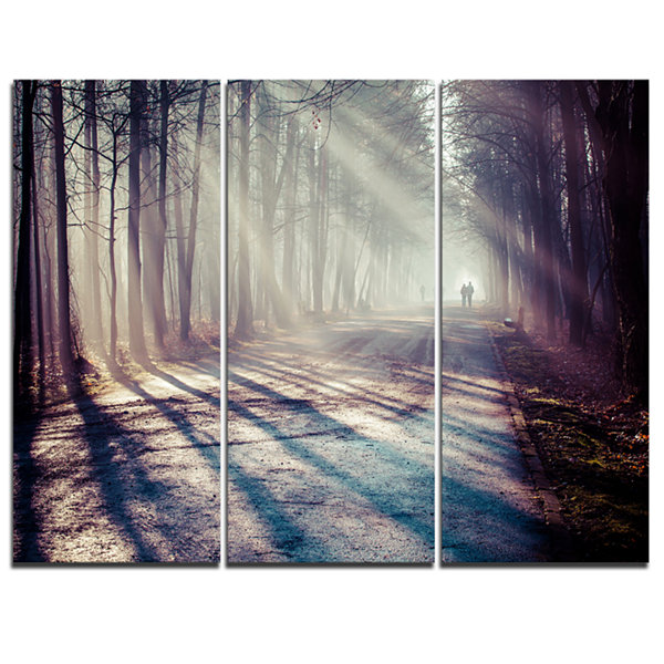 Design Art Strong Sunbeams In Thick Forest Landscape Photography Canvas Print - 3 Panels
