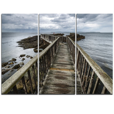 Designart Wooden Pier On North Irish Coastline SeaBridge Canvas Art Print - 3 Panels