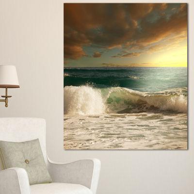 Designart Rushing Waves Under Heavy Clouds Beach Photo Canvas Print