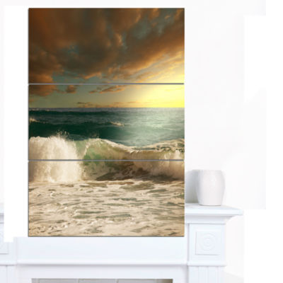 Designart Rushing Waves Under Heavy Clouds BeachPhoto Canvas Print - 3 Panels