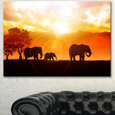 Designart Elephants Walking At Sunset African Canvas Art Print