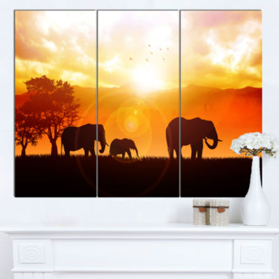 Designart Elephants Walking At Sunset African Canvas Art Print - 3 Panels