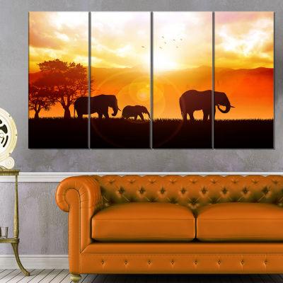 Designart Elephants Walking At Sunset African Canvas Art Print - 4 Panels