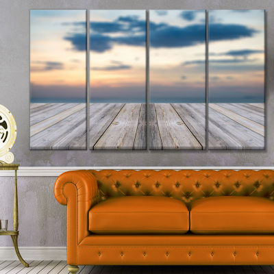 Designart Wooden Board At Sunset Seashore Modern Canvas Art Print - 4 Panels