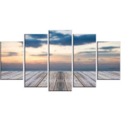 Designart Wooden Board At Sunset Seashore Modern Canvas Art Print - 5 Panels