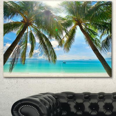 Designart Palm Hanging Over Sandy White Beach Seashore Photo Canvas Art Print
