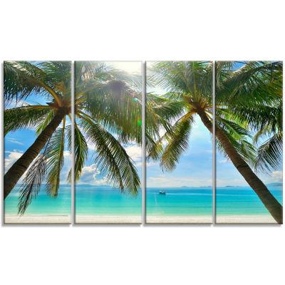 Designart Palm Hanging Over Sandy White Beach Seashore Photo Canvas Art Print - 4 Panels