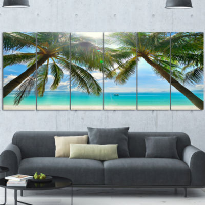 Designart Palm Hanging Over Sandy White Beach Seashore Photo Canvas Art Print - 6 Panels