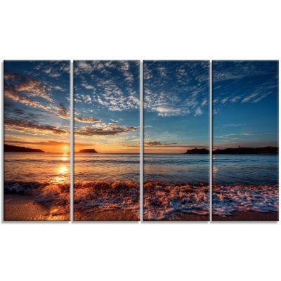 Designart Tranquil Beach And Whimsical Clouds Seashore Photo Canvas Art Print - 4 Panels