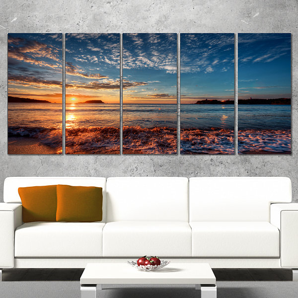Design Art Tranquil Beach And Whimsical Clouds Seashore Photo Canvas Art Print - 5 Panels